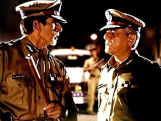 Movie Still From The Film Dev Featuring Amitabh Bachchan,Om Puri