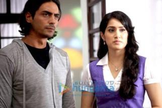 Movie Still From The Film Fox Featuring Arjun Rampal,Sagarika Ghatge