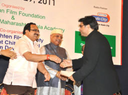 Photo Of Kiran Shantaram,Vinod Kumar From The Vinod Kumar receives award at 10th Asian Film Festival