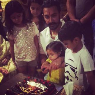 Aamir Khan cuts his birthday cake with son Azad and Imran Khan's daughter Imara