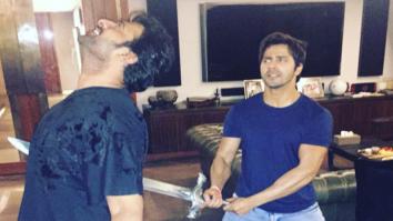 Varun Dhawan stabs Baahubali Prabhas recreating famous Baahubali- Kattappa moment