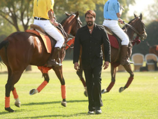 Ajay Devgn walks between a live polo match for the song Mere Rashke Qamar