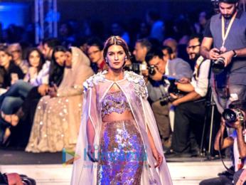 Sidharth Malhotra, Kriti Sanon and Karan Johar walk the ramp for Manish Malhotra's Design One show in Dubai