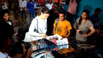 Deepika Padukone cuts a cake for a fan