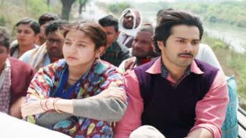 Varun Dhawan and Anushka Sharma travel on the roof of a bus!