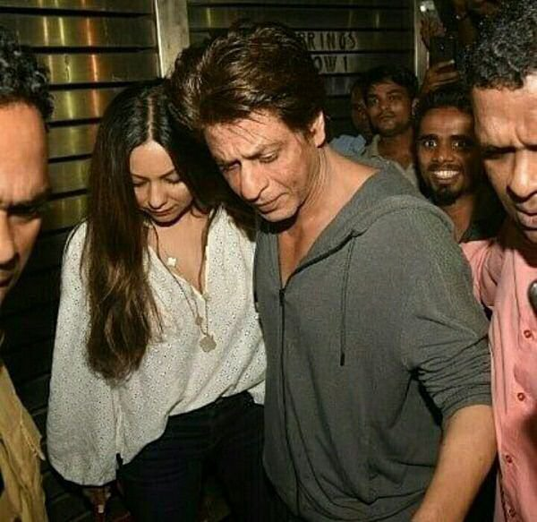 Shah Rukh Khan protecting Gauri from the paps personifies their TIMELESS ROMANCE